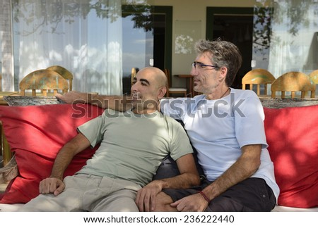 Two male friends meeting  in a cafe - stock photo