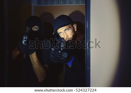 Two male thieves in elevator
