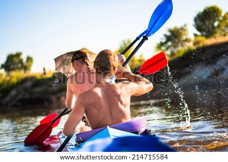 Two man are kayaking on a river  - stock photo