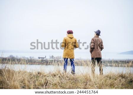 Two man enjoy the lake view - stock photo