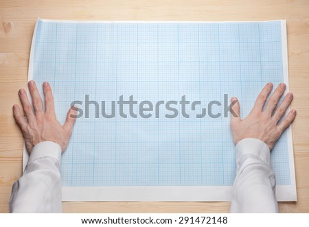 two man hands holding empty blueprint canvas - stock photo