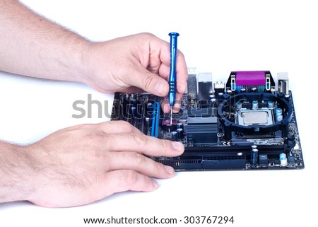 Two Man hands repair electronic board isolated white