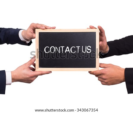 Two man holding mini blackboard with CONTACT US message - stock photo