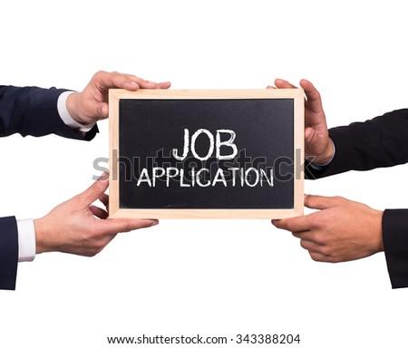 Two man holding mini blackboard with JOB APPLICATION message - stock photo