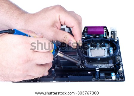 Two man`s hands soldering fee, computer motherboard repair isolated white - stock photo