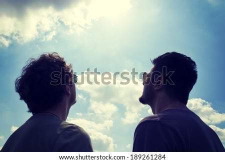 Two man watching on the sky and sun  - stock photo