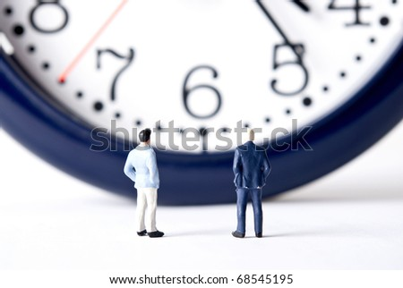 two man with the clock - stock photo