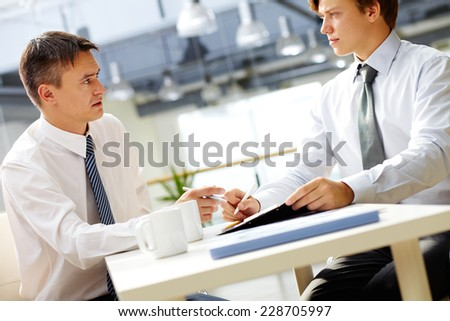 Two managers planning work in office