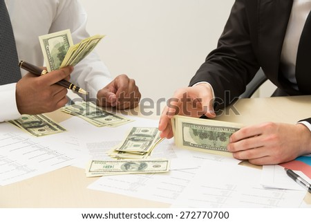 Two managers share earned money. - stock photo