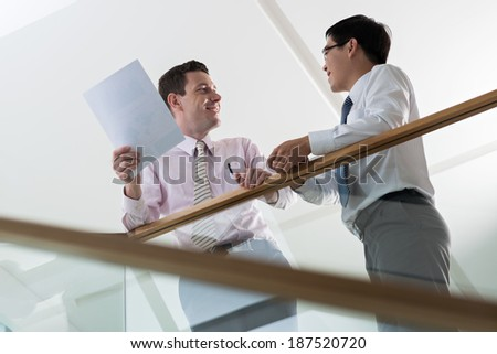 Two managers speaking in the office building - stock photo