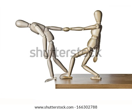 Two manikins, anatomical model, placed on the edge of a board  - stock photo