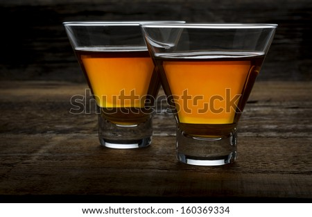 Two maple whiskeys - neat , on rough wood - stock photo