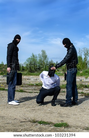 Two masked gunman trying to kill businessman - stock photo