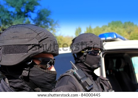 two masked police special unit - stock photo