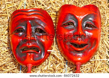 Two masks, comedy and tragedy face masks - stock photo