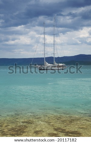 Two-mast yacht in a gulf between mountains