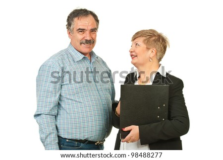 Two mature business people having conversation and laughing together isolated on white background