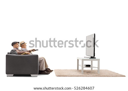 Two mature men sitting on a sofa and watching television isolated on white background