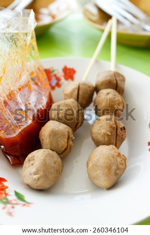 two meatball grilled thai street food on dish photo - stock photo