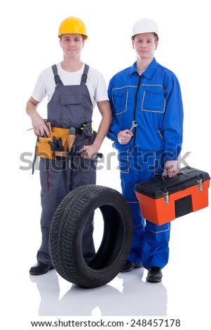 two mechanic with a car wheel and toolbox - stock photo