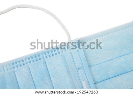 Two medical masks on an isolated background - stock photo
