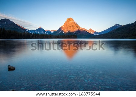 Two medicine lake, glacier national park, in the morning - stock photo