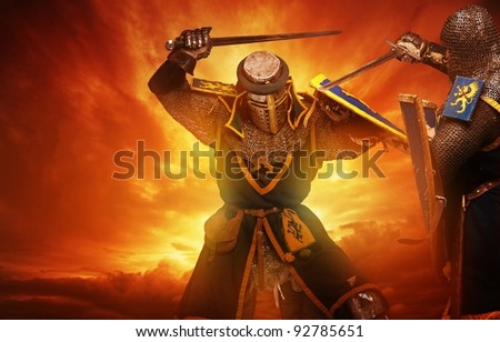 Two medieval knights fights against stormy sky background. - stock photo