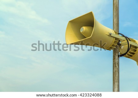 Two megaphones or Loudspeaker in Outdoor blue sky background - stock photo