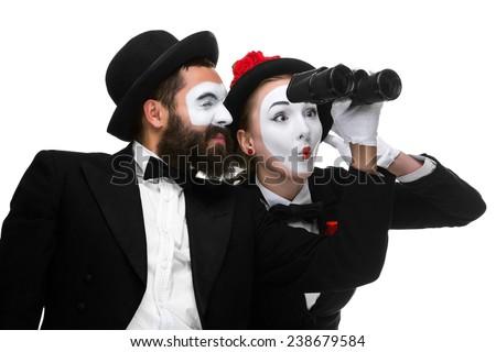 Two memes as business people looking through binoculars - stock photo