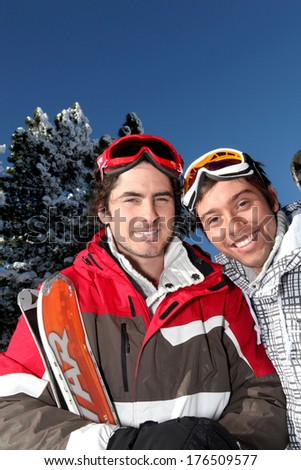 Two men about to ski