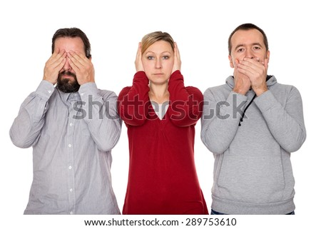 two men and a woman shows the three wise Monkeys  - stock photo