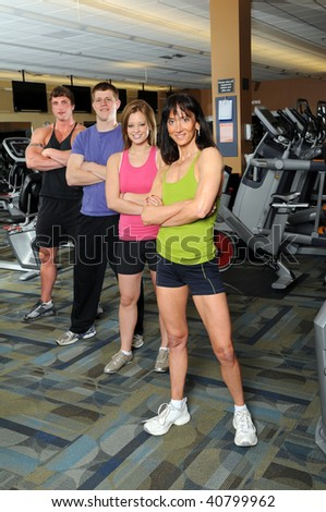 Two men and two women at the gym