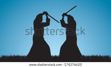 Two men are engaged in aikido against the blue sky - stock photo