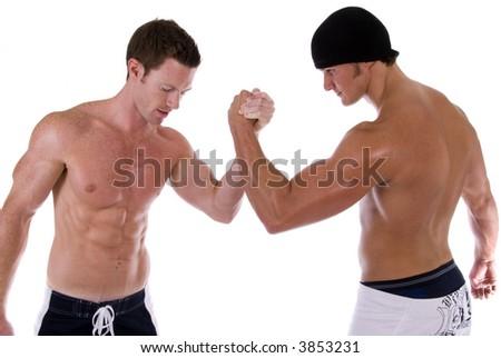Two men arm wrestling. Taken against a white background. - stock photo