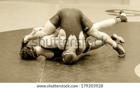 Two Men Battle for Control in Wrestling Match - stock photo