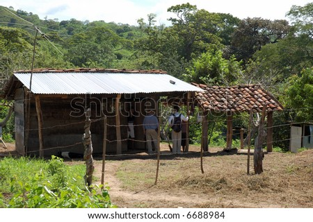 Two men carry out there missionary work in Nicaragua. - stock photo