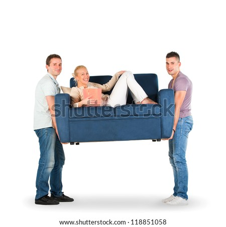 Two men carrying a couch with a woman smiling - stock photo