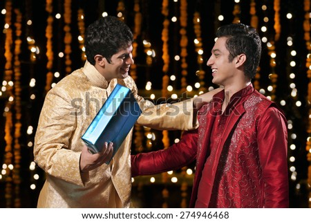Two men greeting each other - stock photo