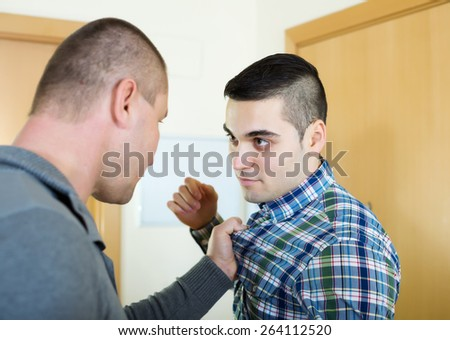 Two  men having fight at home - stock photo