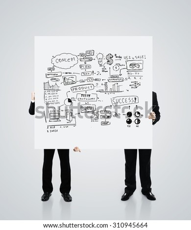 two men holding a poster with business concept - stock photo