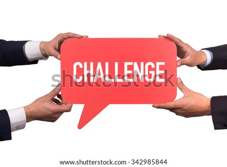 Two men holding red speech bubble with CHALLENGE message - stock photo