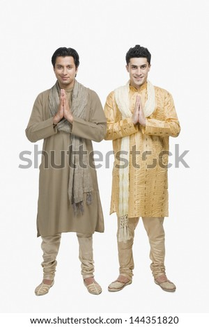 Two men in prayer position - stock photo