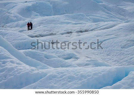 two men on icefield, trekking at perito moreno glacier, patagonia argentina