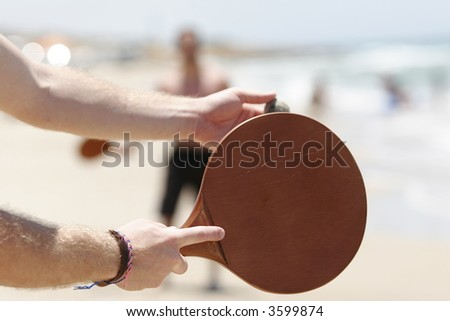Two men playing beach tennis on the beach