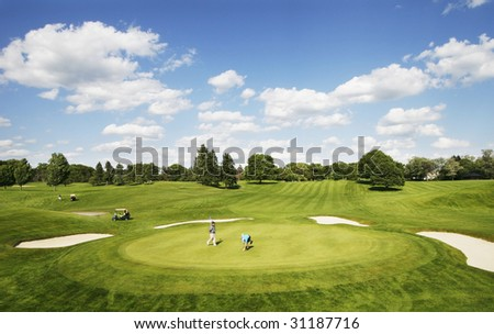 two men playing golf - stock photo