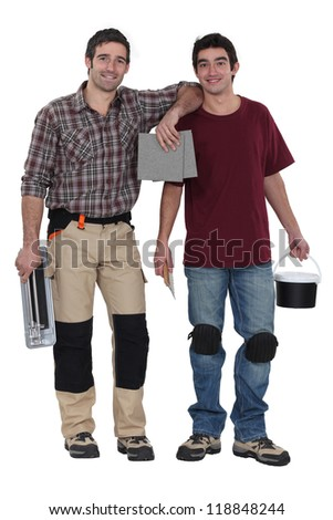 Two men preparing to tile bathroom - stock photo