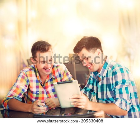 two men sitting at the cafe - stock photo
