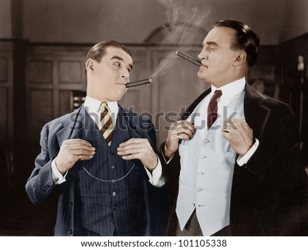 Two men smoking cigars - stock photo