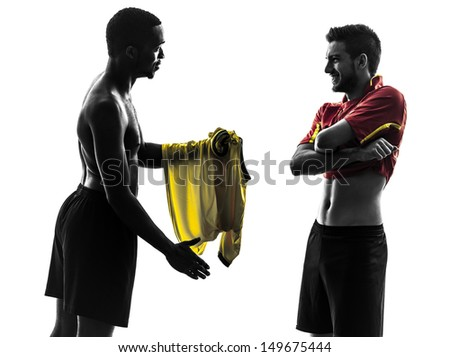 two men soccer player playing football competition exchanging jersey in silhouette on white background - stock photo