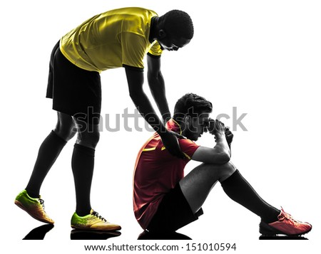 two men soccer player playing football competition  fair play concept in silhouette  on white background - stock photo